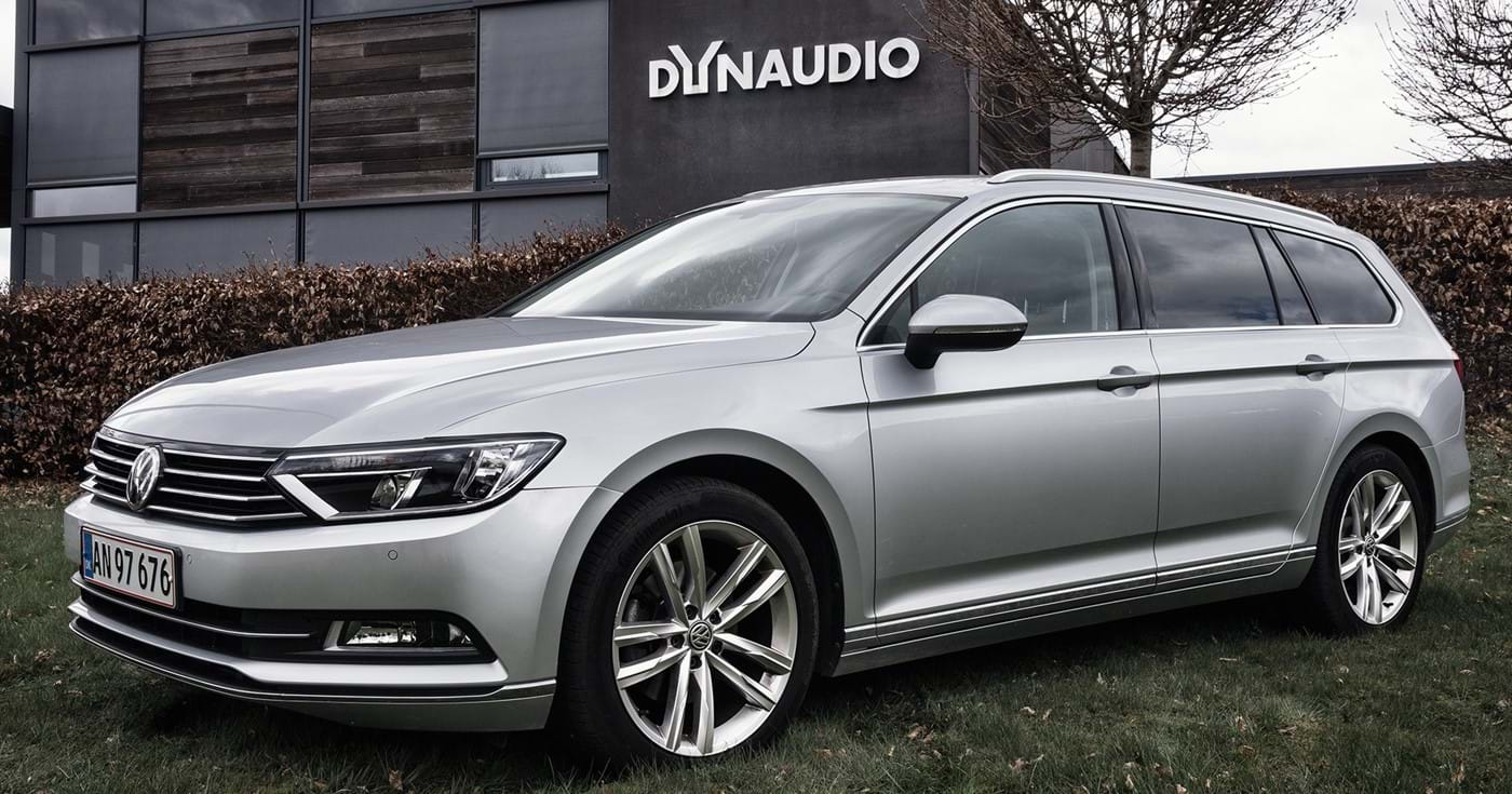 A silver grey Volkswagen Passat B8 with Dynaudio sound system in front of Dynaudio's offices in Denmark